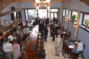 The Downtown Council of Kansas City hosted a ribbon-cutting ceremony Thursday in the new Milwaukee Delicatessen Co. space to celebrate completion of first-floor renovations at the historic Cosby Hotel building.