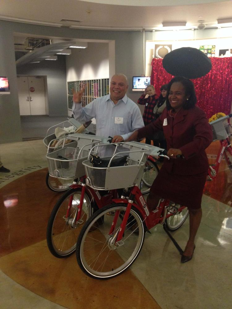 Mayor Pro Tem Sheryl Cole and City Councilman Mike Martinez try out two of the B-Cycle bikes during a launch party in December. Usage of the B-Cycle system is exceeding projections.