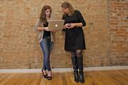 Two members of the AlphaWoman team go over details of their pitch.