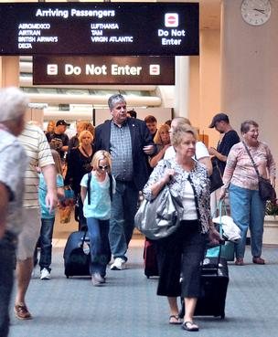 International travelers file into Orlando International Airport terminal.