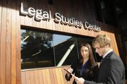Elise Sisson and Russell Frink look over their notes in front of the Legal Studies Center.