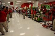 Target employees meet to discuss preparations for Black Friday two weeks before the event.
