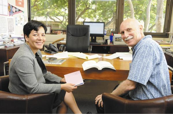 Elisabeth Steele Hutchison, left, director of admissions at the University of Hawaii William S. Richardson School of Law, and Dean Avi Soifer discuss marketing strategies for the law school following a drop in applications here and at other law schools across the nation.