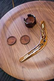 A boomerang represents the Australian roots of the company.