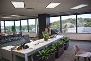 Managing director of Macquarie's Nashville office, Jennifer Coyle, has her office in the common space, indicative of the company's corporate culture.