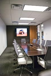Heavy-duty mining equipment is on display in one of the conference rooms.