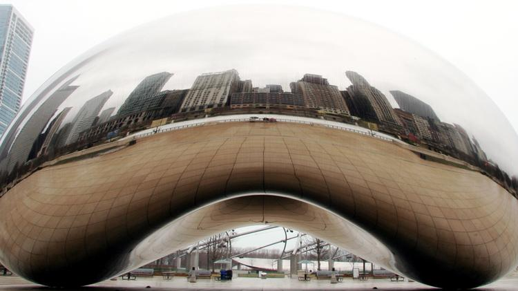 """The sculpture commonly called """"The Bean"""" at Millennium Park in Chicago. Local officlals envision a pedestrian-friendly corridor comparable to Millennium Park that could link the Wisconsin Center convention hall with a new downtown arena."""