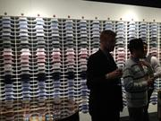 A wall of shirts at the new Suitsupply, 299 Detroit St.
