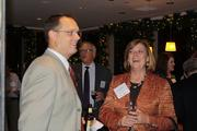 An unidentified guest shares a laugh with Kathy Hunter of Bank Midwest.