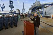 Secretary of Defense Chuck Hagel addresses shipyard workers and sailors after touring the USS Zumwalt, DDG-1000, at Bath Iron Works.