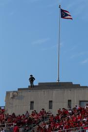 That's Franklin County Sheriff's Deputy Kyle Biegler, who not only works each Ohio State game but volunteers for that spot, alongside fellow Deputy Richard Verhoeven, atop the northeast and northwest towers. They've got binoculars to look for suspicious activity and are in direct contact with teams on the ground. And yes, his perch is sloped down toward the stands, making for a stressful several hours on the calves - and nerves.