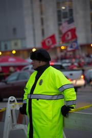 Managing those crowds is the job of about 400 law enforcement personnel on duty at each Ohio State home game, split between OSU's police force, the Ohio State Highway Patrol, about 100+ members of the Columbus Division of Police and another 100+ from the Franklin County Sheriff's Office. Columbus police officers like Mike Paulins are on special duty working for the OSU police department and have to request the day off from the Columbus force.