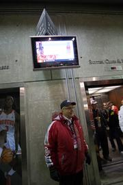 The most-visible people working on game-day are the Redcoats and their black-jacketed colleagues, the ushers. The approximately 450 Redcoats work mostly inside, scanning tickets at the gate and staffing the corporate suites, the press box, elevators and such. There are also about 600 ushers, mostly at the portal entrances to help fans find their seats. And about 200 contract workers provide extra security and check bags at the gate.