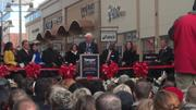 The Peterson Cos. President and CEO Milt Peterson and others prepare to cut the ribbon at Tanger.