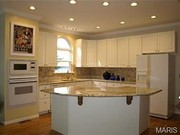 33 Yorkshire Lane Court: The kitchen features granite counter tops and a custom-built island.