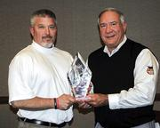 """CBJ Seen: Jim Correll of the Greater Hickory Kia Classic (right) presents the award to Pete Lail.Want to have your events featured? Send photos and caption information to production@bizjournals.com with """"CBJ Seen in the subject line."""