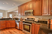 9102 Madge Ave.: The kitchen features a stone backsplash and custom cabinets.