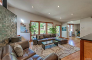2311 Saint Clair Ave: The family room features a vaulted ceiling.