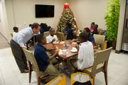 Burr & Forman attorney Eric Golden visits with the children while they enjoy their holiday treats.