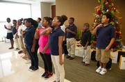 Orange Center Elementary students performed holiday songs for Burr & Forman's attorneys and staff.