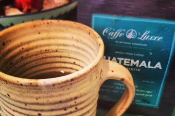 A Larry Carnes-created coffee mug and a cup of Caffe Luxxe's new Guatemala blend -- two forms of art to start the day.