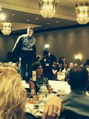 Phoenix Mayor Greg Stanton takes his jacket off to show off his fancy shirt on the Debbie Gaby Celebrity Catwalk.