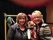 Lowery backstage with Gabriel's Angels founder Pam Gaber and therapy dog Snickers, a Pomeranian.