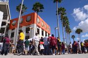 Fans make their way around the facade of the Citrus Bowl before the start of the 2013 Florida Classic football game.