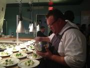 Chef Chris Shepherd of Underbelly checks over the first course.