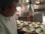 Chef Philip Speer of Uchi prepares the first course, sunchoke dashi with Thai chili and apple.