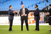 From left: Commentators Steve Young, Trent Dilfer and Ray Lewis on the field at Bank of America Stadium.