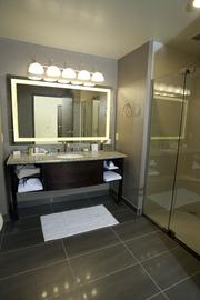 The bathrooms have granite countertops and lighted vanities.