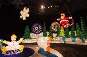 Santa Claus snowboards, snowmen dance and snowflakes hang from the ceiling in this playground area.