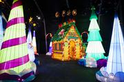 The Snowfall Forest features colorful luminaries, a gingerbread house and hundreds of moving parts.