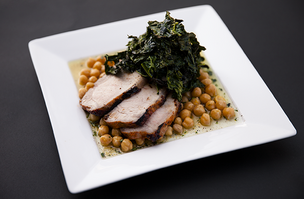 A sample offering from Sprig: Spanish Pork loin marinated in harrisa and honey, served with citrus scented garbonzo beans, mushrooms and roasted kale.