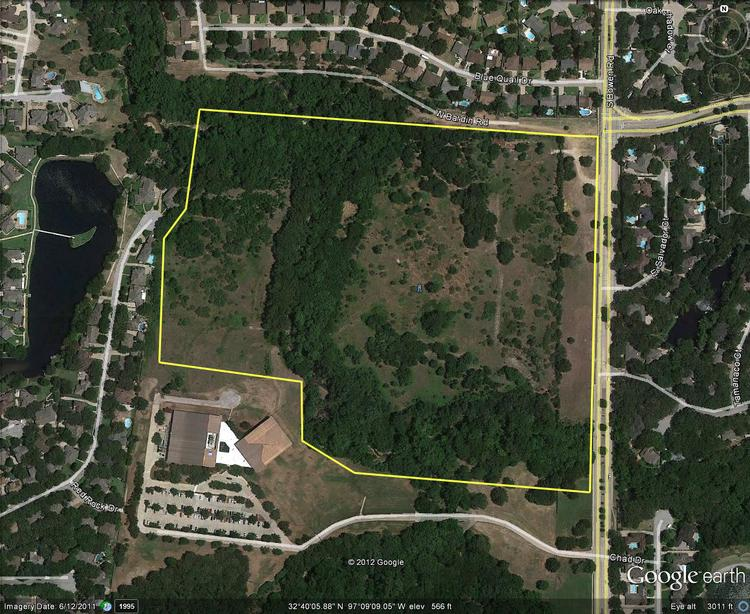 A Behringer Harvard affiliate has sold nearly 41 acres of land in southwest Arlington to Athlos Academy for a school.