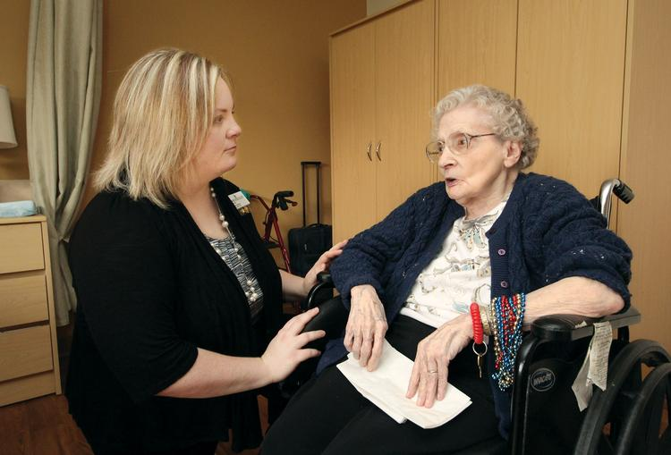 Asbury Heights Assistant Administrator Anneliese Perry chats with resident Virginia Dorrenbacher at the care center's Mt. Lebanon facility.