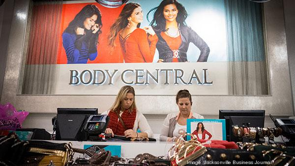 Orange Park Mall Body Central Store Manager Trisa Alsobrook, right, works the counter with a store associate.