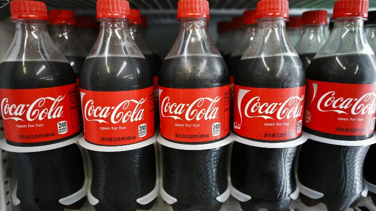 Bottles of Coca- Cola Co. soda are displayed for sale at a convenience store in Redondo Beach, California, U.S.