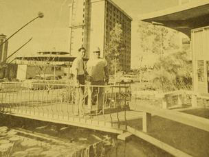 The Pagoda Hotel-Apartment and Floating Restaurant complex on Rycroft Street was nearing completion in February 1964. Surveying the miniature lake surrounding the restaurant were developer J.T. Hayashi, left, and assistant project superintendent George Sawamura.