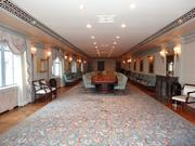 The main board room in the former Riggs National Bank headquarters. Original banking ledgers of Abraham Lincoln, George W. Riggs and Elisha Riggs are framed on the walls.