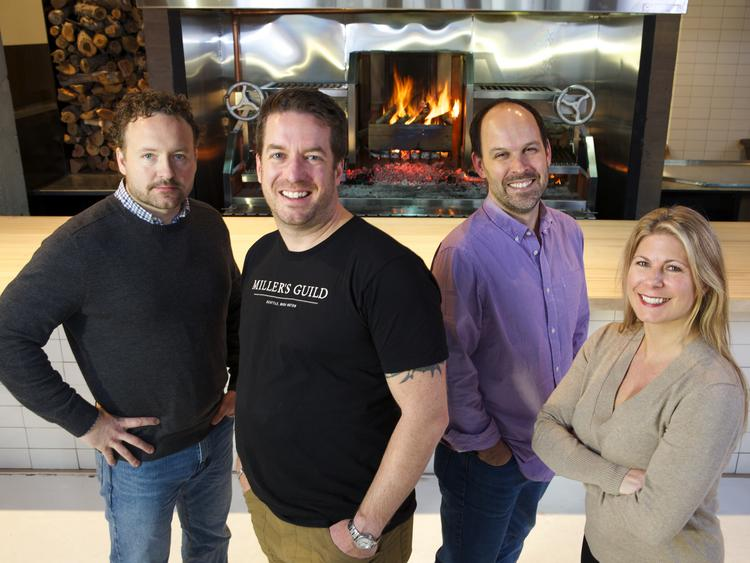 Kurt Huffman (from left), Jason Wilson, Jake Kosseff and Nicole Wilson are the partners behind Miller's Guild in downtown Seattle, which is experiencing a resurging restaurant scene.