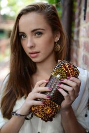 "Laura Lee Designs features intricately beaded handbags ranging from the small ""M"" bag — for the ""minimum: makeup, money, mobile"" — shown here to the larger toes. Available online at http://www.lauraleedesigns.com."