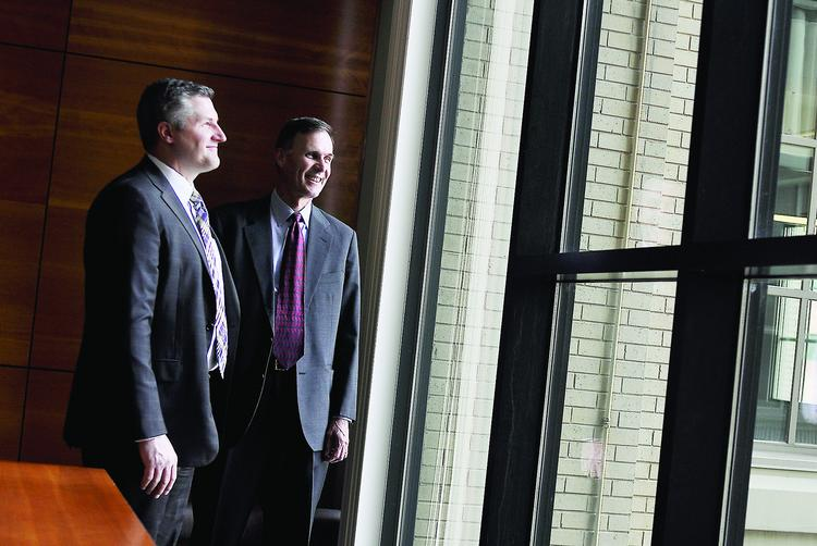 Adam Fiedor, left, a principal at St. Charles Capital, with Wes Brown, managing director.