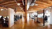 Exposed ceilings highlight the wood structure at Roundhouse's offices.
