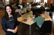 """Pamela Rivers, client manager for Goodfunds Wealth Management, works at the Hub in Seattle's Pioneer Square when she's not at the firm's Ballard offices. She says clients often have outdated ideas on socially responsible investing. """"Years ago, you often did give up performance for social investment, but times have changed dramatically,"""" she said."""