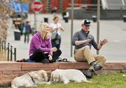 Some young people take a break in Commons Park near Little Raven and 15th streets.