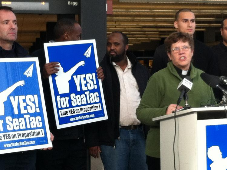 The Rev. Jan Bolerjack speaks to a victory rally of Proposition 1 supporters at Seattle-Tacoma International Airport Tuesday. Bolerjack says airport workers currently use her church's food bank.