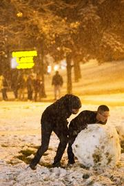 Students made a snowman on the Oval outside one of the entrances to the fenced-off Mirror Lake.