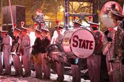 Members of the band did their best to stay warm after warming up the crowd.